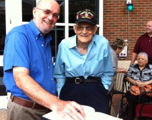 Earl Cragon Baggett, a Purple Heart veteran of World War II, already had read the book but attended the signing anyway.