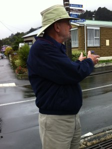 Here I am trying to decide whether to hike up the Steepest Street in the World. See signs above my head.