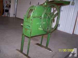 Our John Deere corn sheller was a newer model than the one in the this photo and the one in the YouTube video, but ours worked on the same principle. We powered it with an electric motor on the floor connected by a belt to the large wheel on the sheller. (Source)