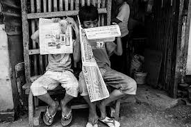 Decidedly not 72nd Street in New York, this image from Tacloban City in the Philippines reminded me of the reading intensity of the two boys in New York. (Source)