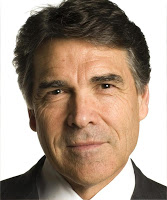 Texas Governor Rick Perry, wearing his nice hair. My baldness makes me really jealous. (Source.)