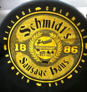 My first free restaurant T-shirt from Schmidt's Sausage Haus, Columbus, Ohio, draped over the steering wheel after a superb lunch there on June 8, 2014.