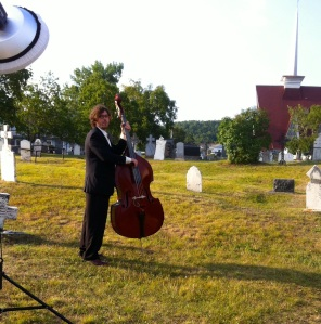 Alex the bassist, playing in a cemetery in Tadoussac, Quebec, Canada, August 1, 2014.